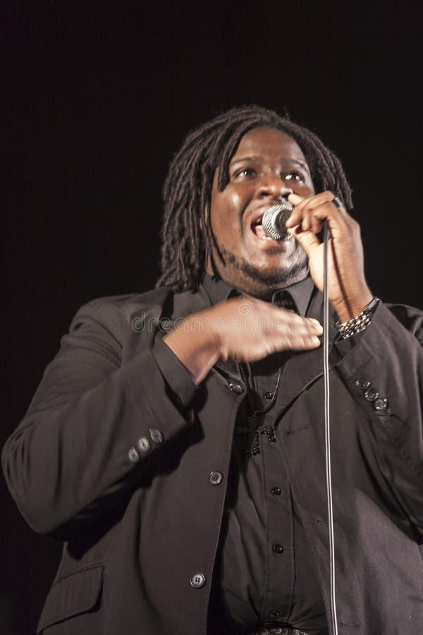 Gospel singer in concert. Gospel singer is singing during a concert in Roveredo in Piano (Italy stock photography