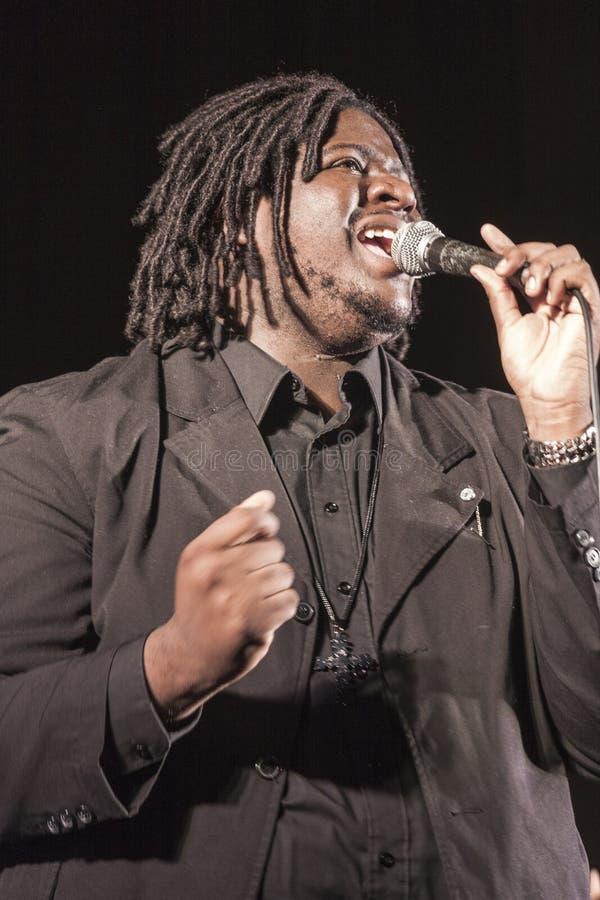 Gospel singer in concert. Gospel singer is singing during a concert in Roveredo in Piano (Italy stock photos