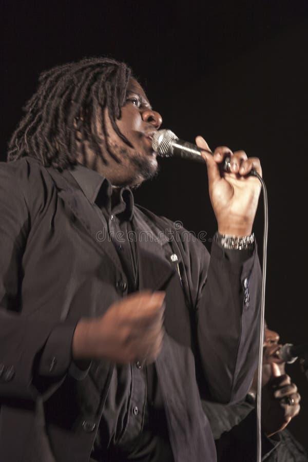 Gospel singer in concert. Gospel singer is singing during a concert in Roveredo in Piano (Italy royalty free stock photo