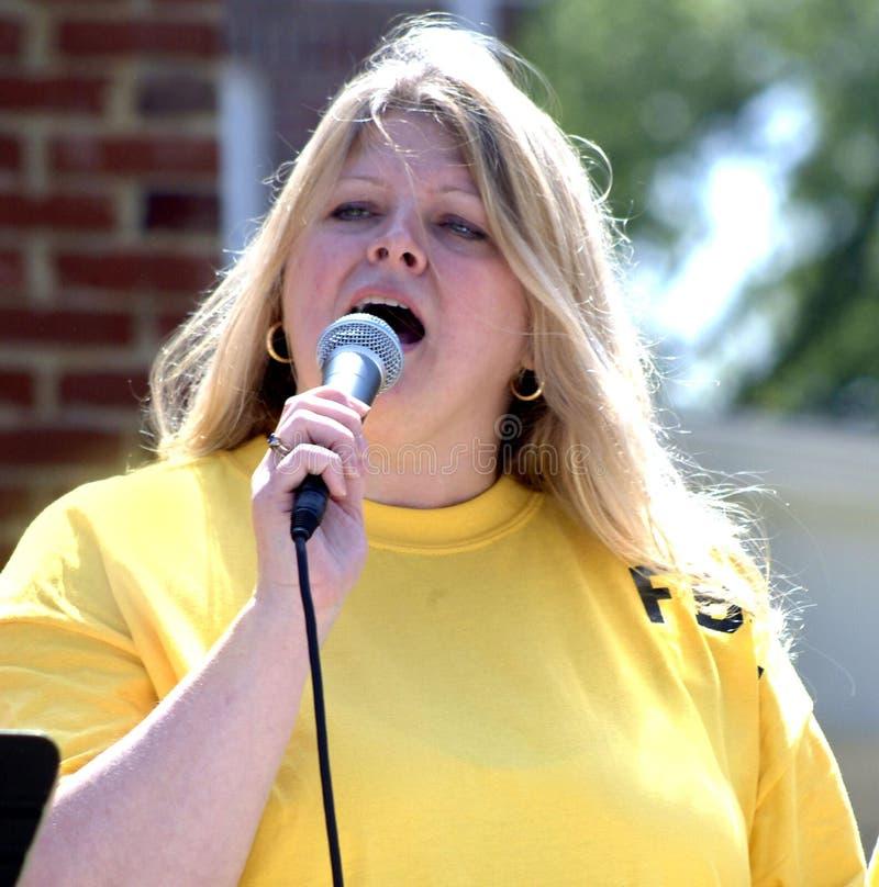 Gospel singer singing at the Main Street Festival. Gospel singer in Laurel Maryland at the Main Street Festival royalty free stock image