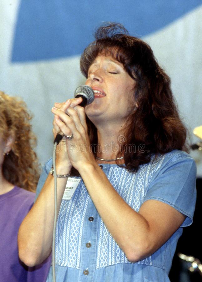 Gospel singer singing praise and worship songs at a retreat. Woman singing gospel music, at a Christian retreat in Indiana,Pennsylvania stock image