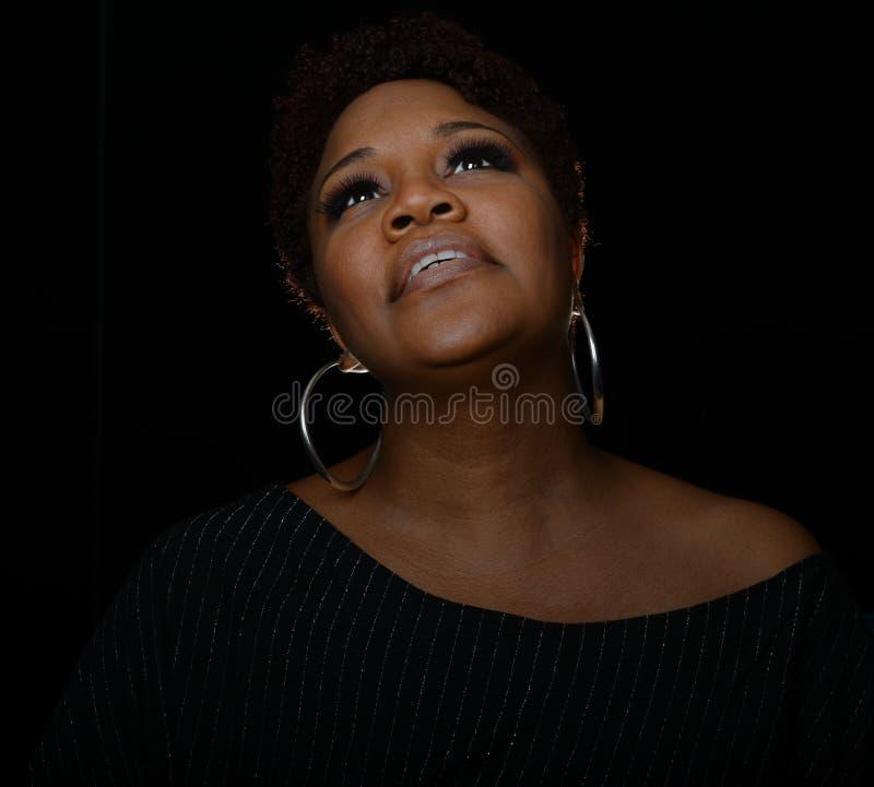 Gospel Singer. Very Nice Portrait of a Gospel Singer on Black stock photo