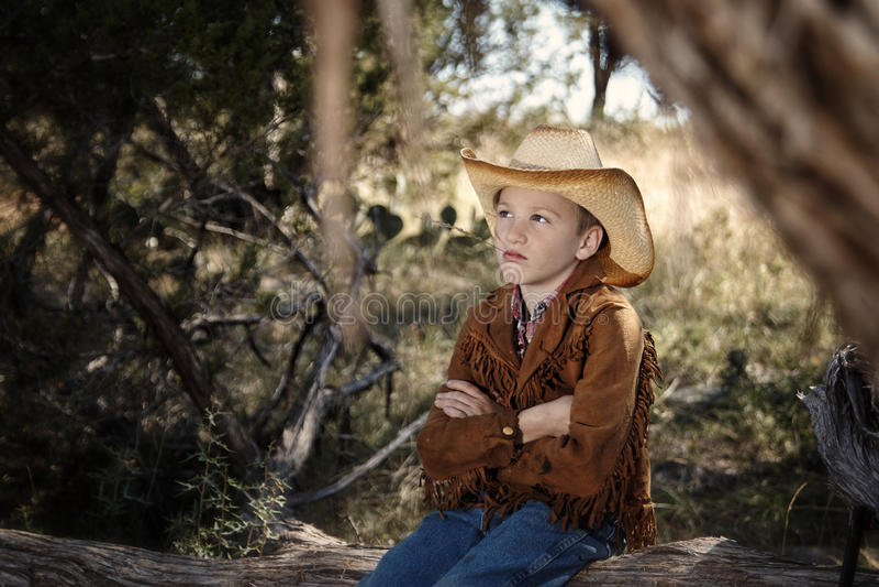 Gosse de cowboy photographie stock