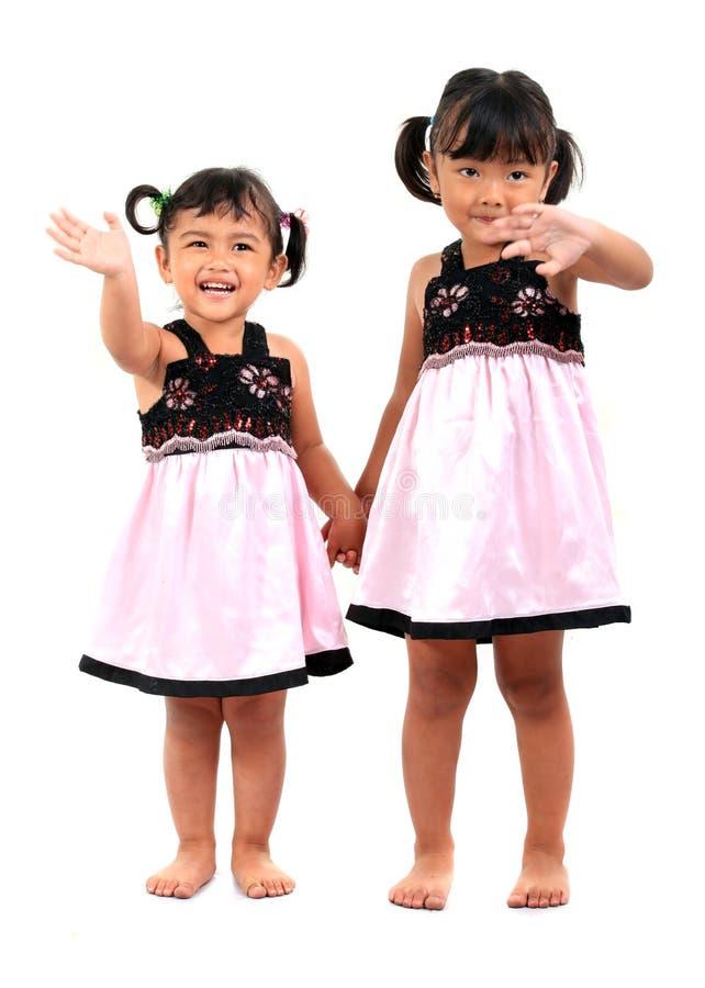 Gosses asiatiques adorables heureux photos stock