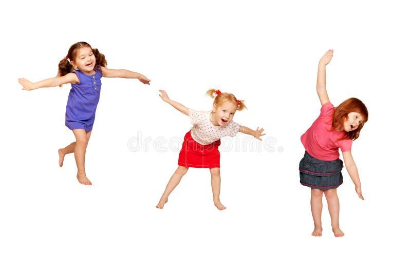 gosses heureux de danse D'isolement sur le blanc photos libres de droits