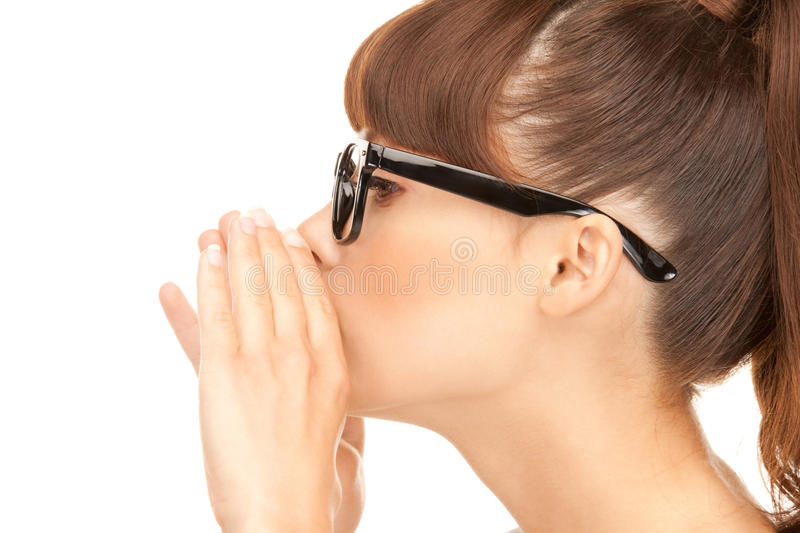 Gossip. Bright picture of young woman whispering gossip royalty free stock photo
