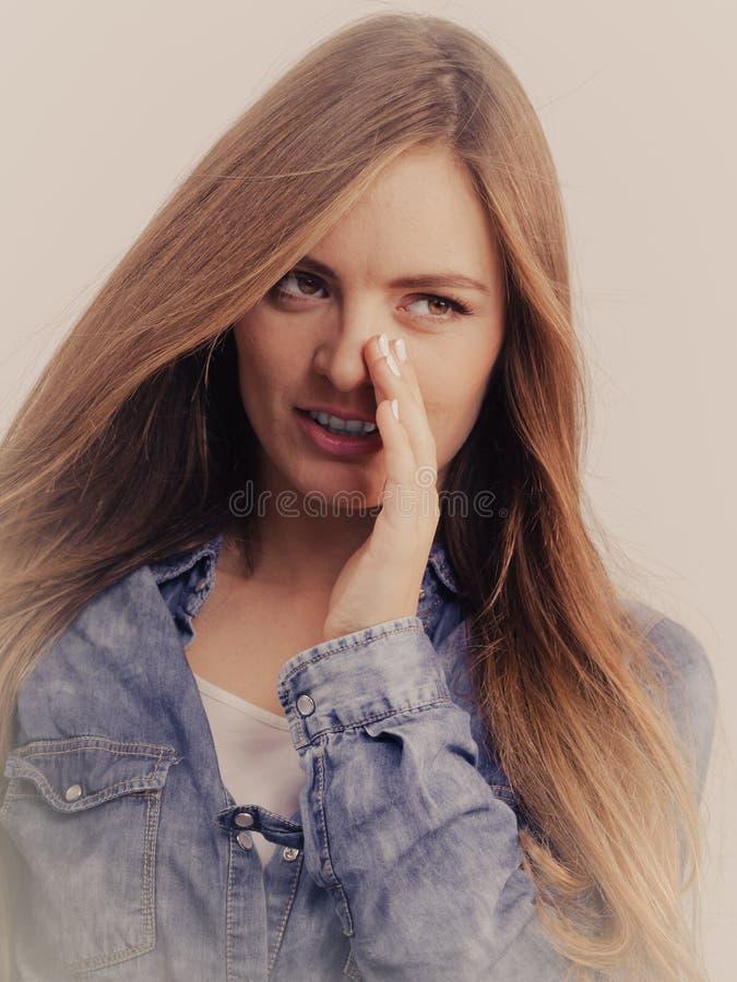 Gossip girl wearing denim shirt. stock photo