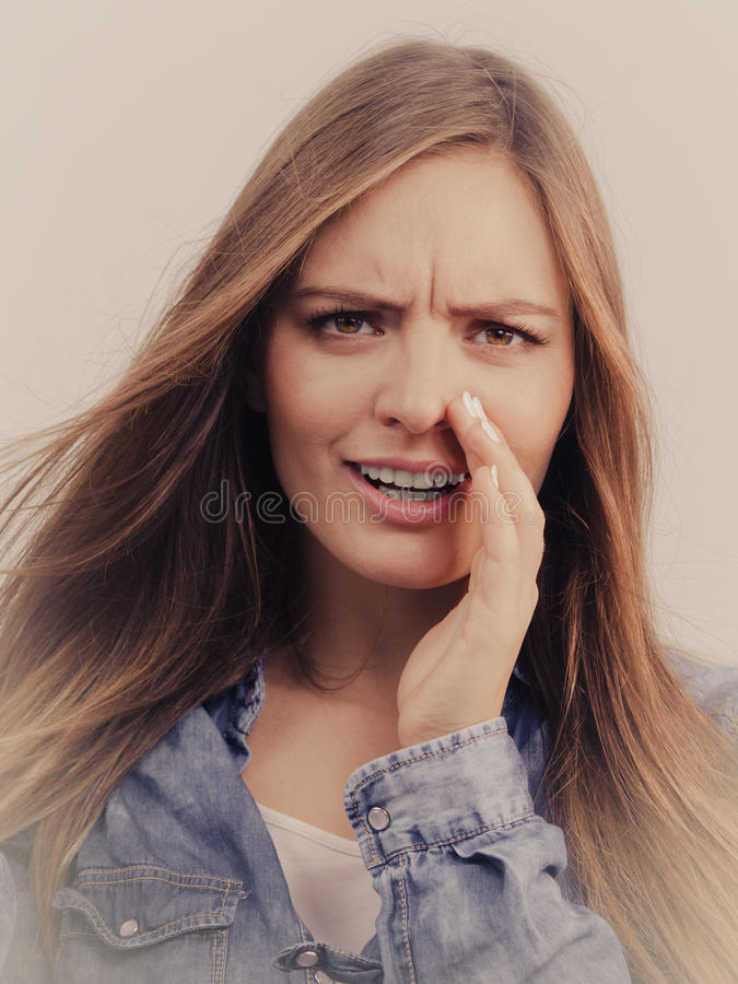 Gossip girl wearing denim shirt. royalty free stock photo