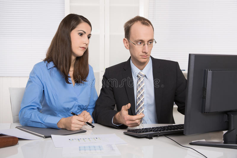 Gossip and harassment under business people on workplace - critic, chicane and censure. royalty free stock image