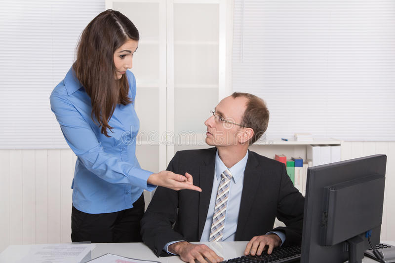 Gossip and harassment under business people on workplace - critic, chicane and censure. Problems under colleagues at work: mobbing and gossip concept royalty free stock photos