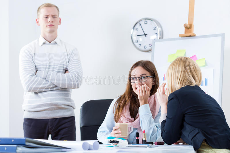 Gossip in the office stock image