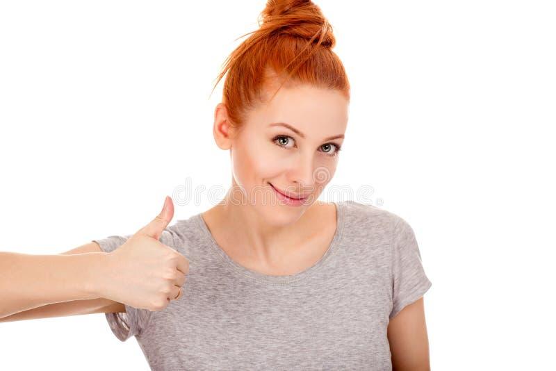 Gosto da exibição da mulher, polegar acima do gesto foto de stock royalty free