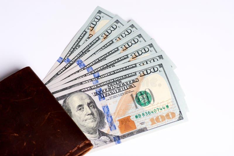 Gotówka dolar notatka, dolarowy tło Udzia? sto dolarowych rachunk?w zako?cze? Dolary w portflu na bia?ym tle obrazy royalty free