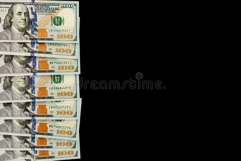 Gotówkowa dolara amerykańskiego pieniądze granica na czarnym tle z kopii przestrzenią obrazy stock