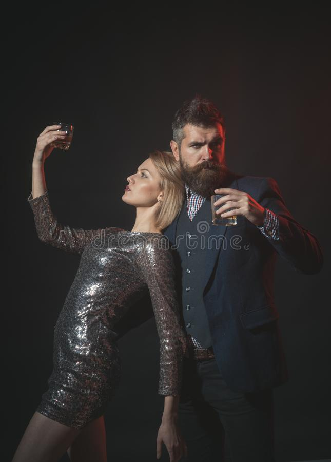 Got drunk at office holiday party. Man in suit and fancy lady at corporate party drinking. Celebration alcohol concept royalty free stock photos