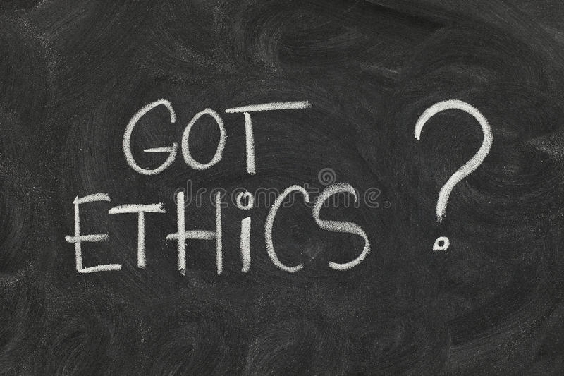 Got ethics ?. Got ethics? Are you ethical question handwritten with white chalk on blackboard with eraser smudges stock image