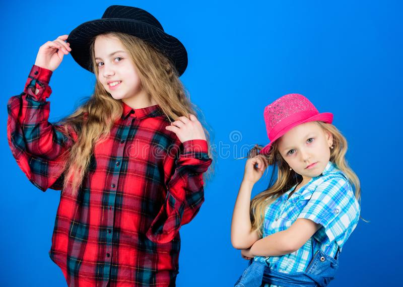 They got great style. Small cute fashion models. Fashionable children in fashion clothing and accessories. Little girls royalty free stock image