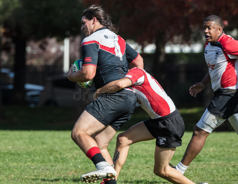 Got Him. Rugby action on the field in Redding, California stock image