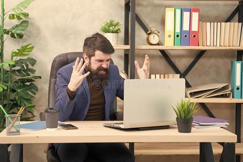 Got into mess. Man bearded boss manager sit office with laptop. Manager solving business problems online. Business man. Failed. Risky business. Broker and stock image
