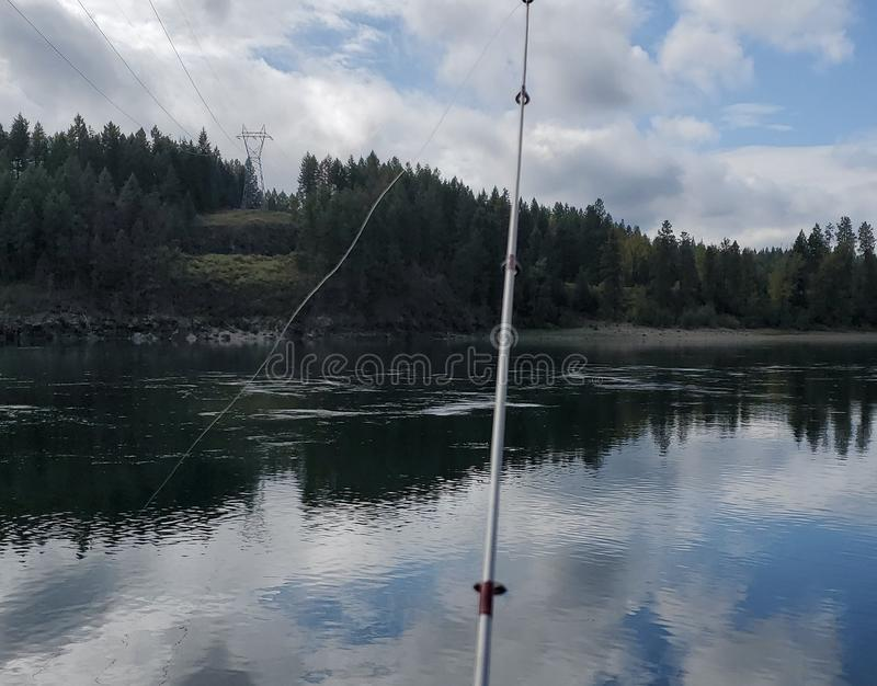 Got my pole, my heart, all I need is some fish. stock image