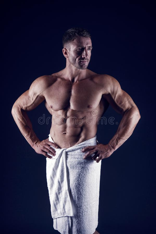 He got perfect torso. Sportsman with muscular chest and belly. Sportsman bodybuilder with six pack. Sexy man in bath stock photography