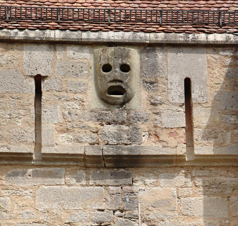Got Pitch Mask on the Burgtor in Rothenburg royalty free stock image