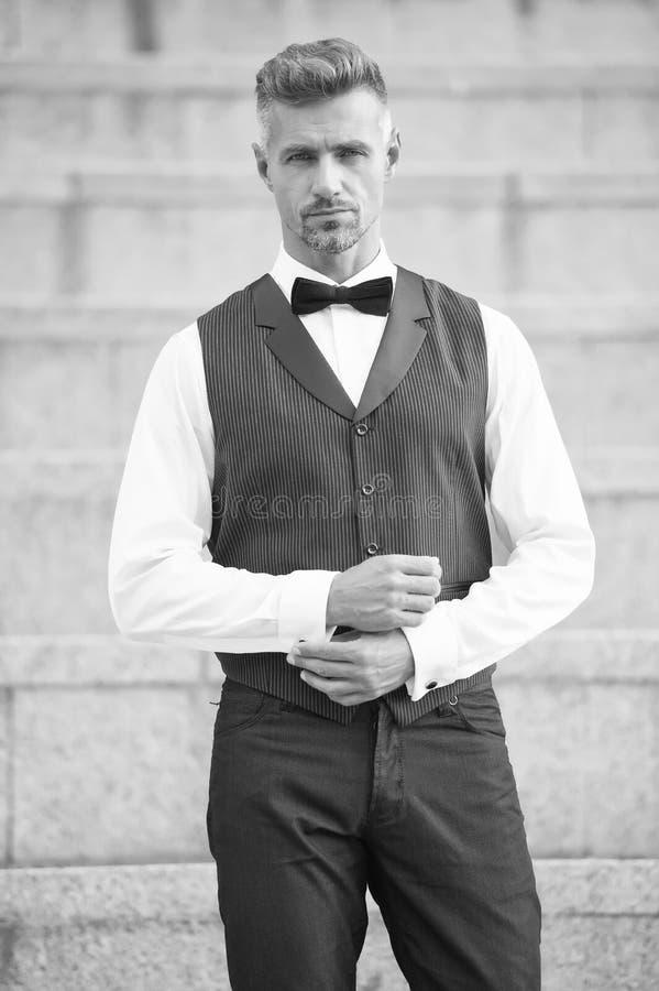 He got style. Gentleman modern style. Guy well groomed handsome bearded gentleman macho wear shirt and vest. Barber shop stock photography
