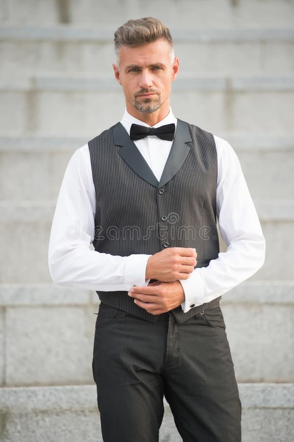 He got style. Gentleman modern style. Guy well groomed handsome bearded gentleman macho wear shirt and vest. Barber shop royalty free stock photography