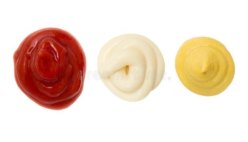 Gota de la mancha de la mostaza y de la mayonesa de la salsa de tomate foto de archivo