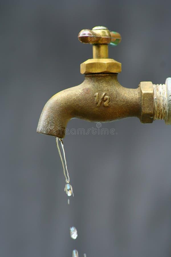 gota de la tabulación del agua o del agua foto de archivo