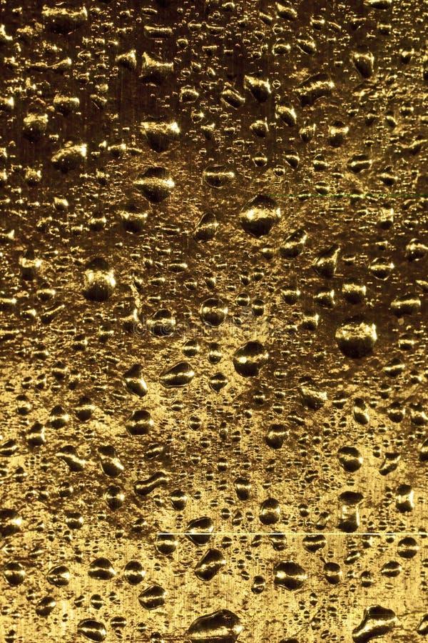 Gota dourada da água imagens de stock