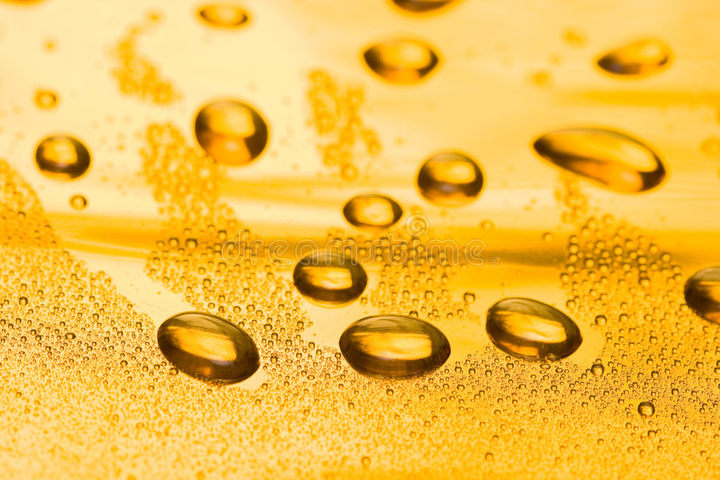 Gota dourada da água imagens de stock royalty free