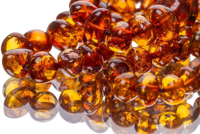 Gotas ambarinas en el espejo fotografía de archivo libre de regalías
