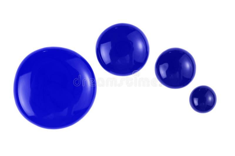 Gotas azules de la pintura foto de archivo