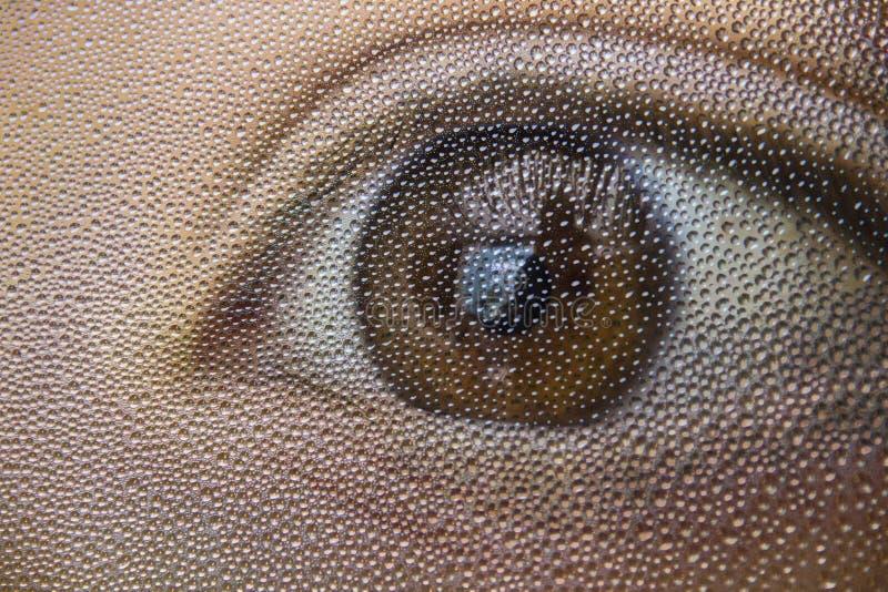 Gotas de água sobre um olho fotografia de stock
