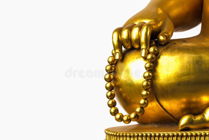 Gotas de rezo en la estatua de la mano de Buda fotos de archivo