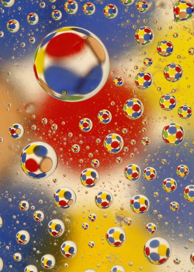 Gotas del agua con los círculos foto de archivo libre de regalías