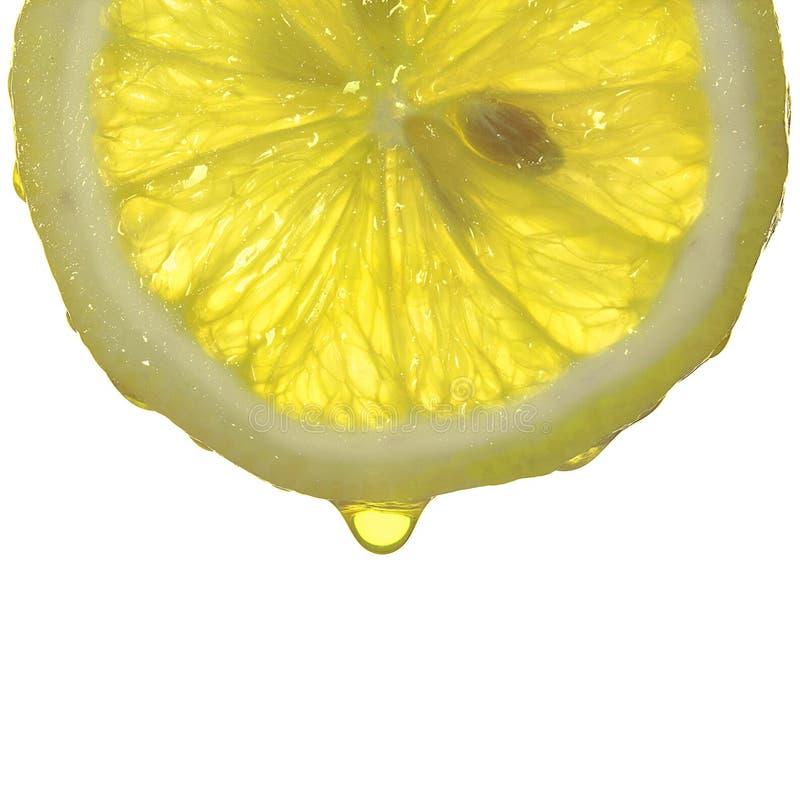 Gotas del jugo de limón imagenes de archivo