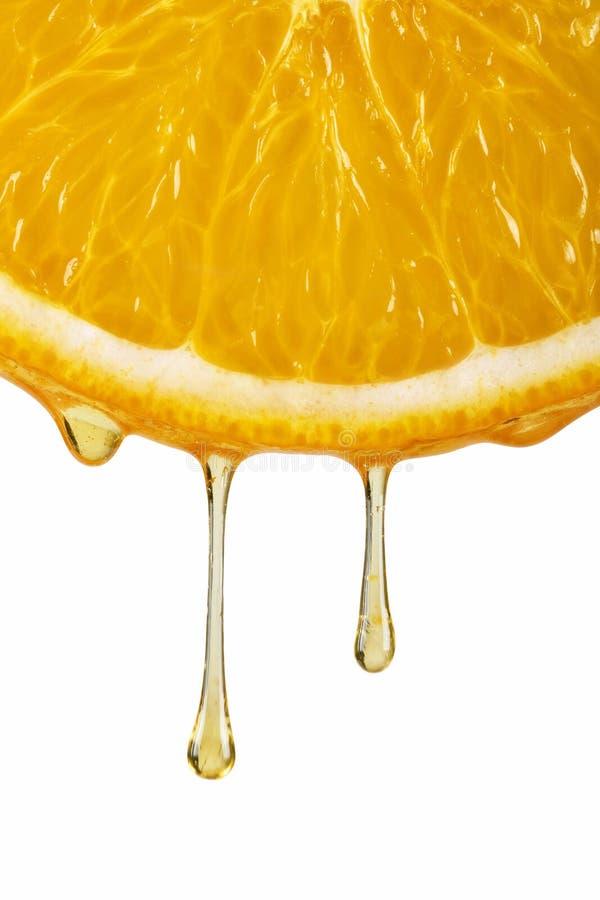 Gotas do sumo de laranja imagem de stock