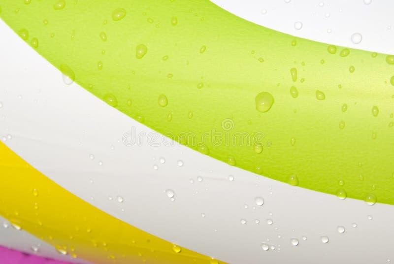Gotas e cor da água imagens de stock royalty free
