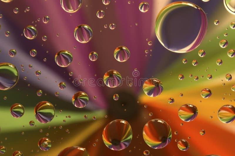 Gotas em um arco-íris imagens de stock