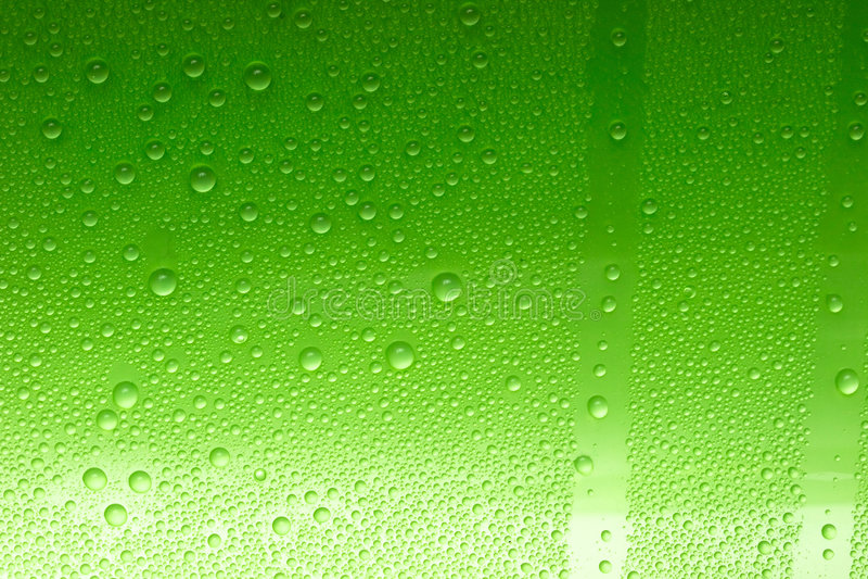 Gotas verdes del agua foto de archivo