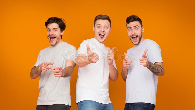 Gotcha. Excited friends pointing fingers at camera royalty free stock photo