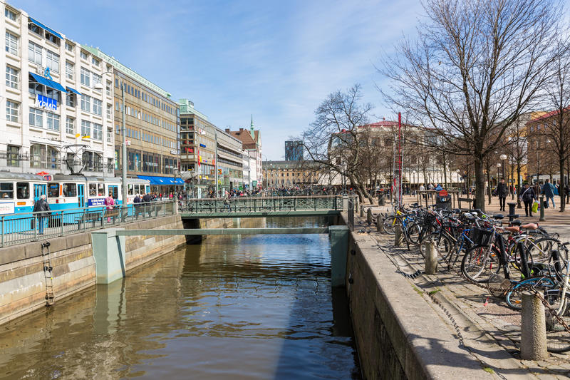 GOTEBORG, SWEDEN - APRIL 26: Unknown people shoppi. Ng in the center of the city Goteborg with a canal on April 26, 2013 in Goteborg, Sweden stock photography