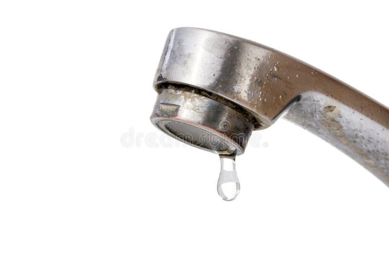 Gotejamento da água do torneira velho fotografia de stock