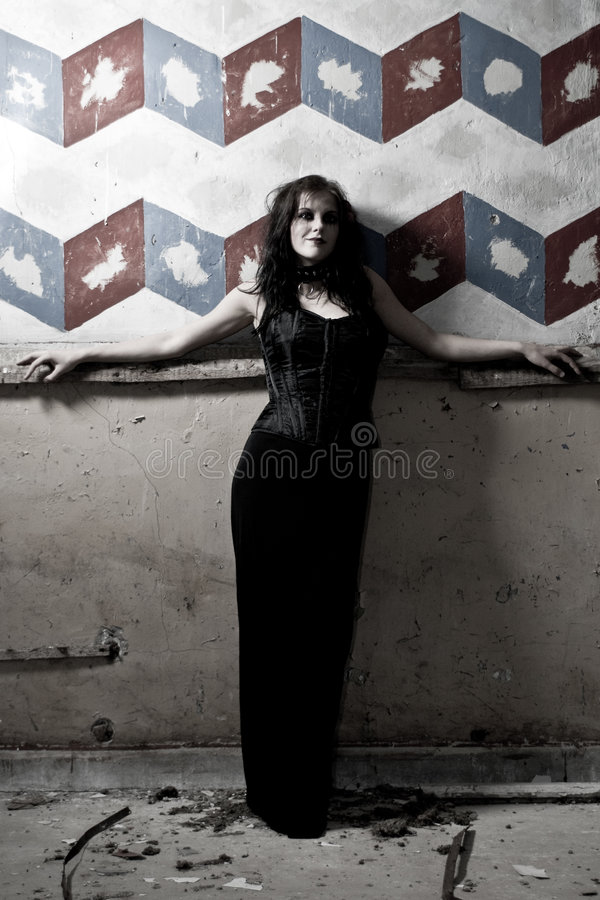 Goth girl against painted wall royalty free stock photos