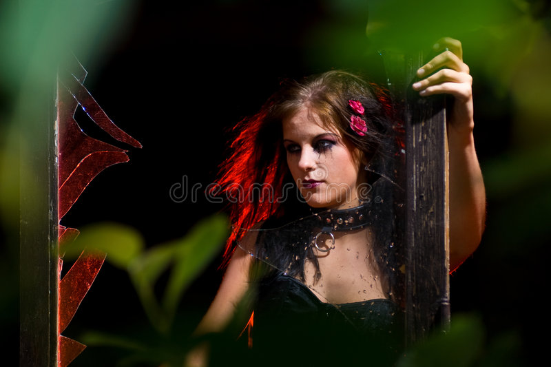 Goth girl and broken glass stock photography