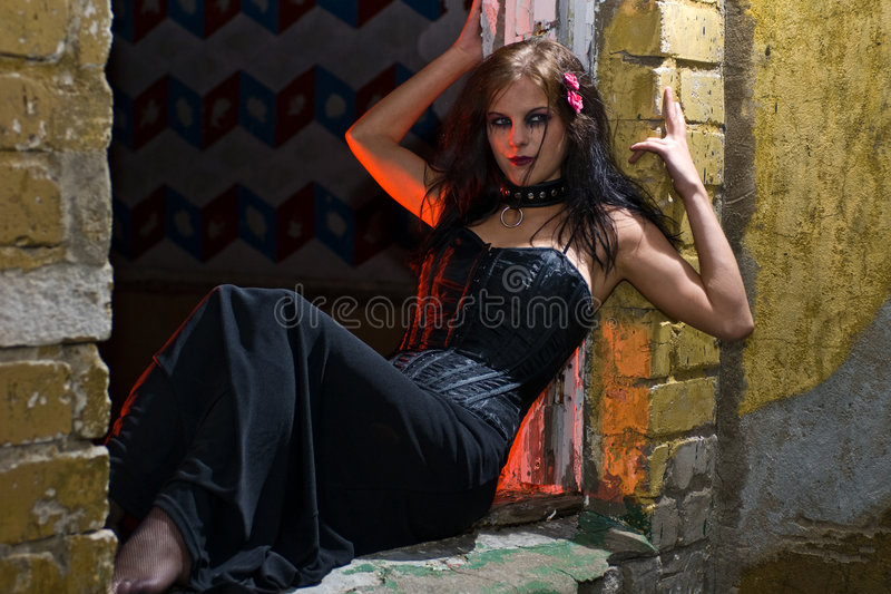 Goth Girl In Old Window Sill Stock Photo