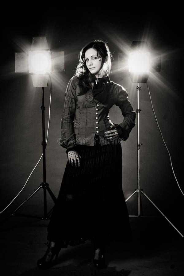 Goth girl portrait with studio spotlight royalty free stock photography