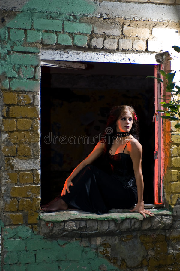 Goth girl in the window royalty free stock photos